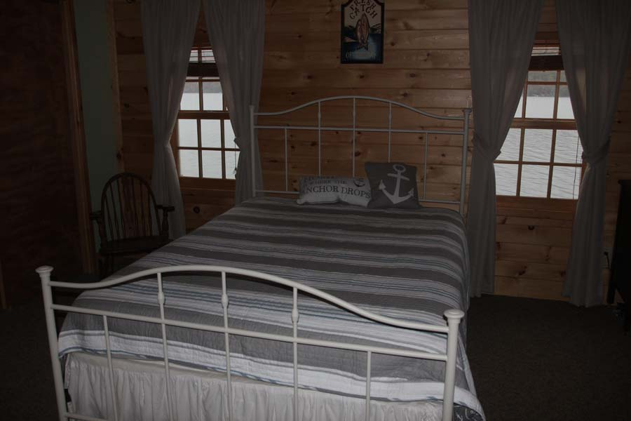 Front bedroom with queen-sized bed at Summer Ice Cottage overlooking Keuka Lake
