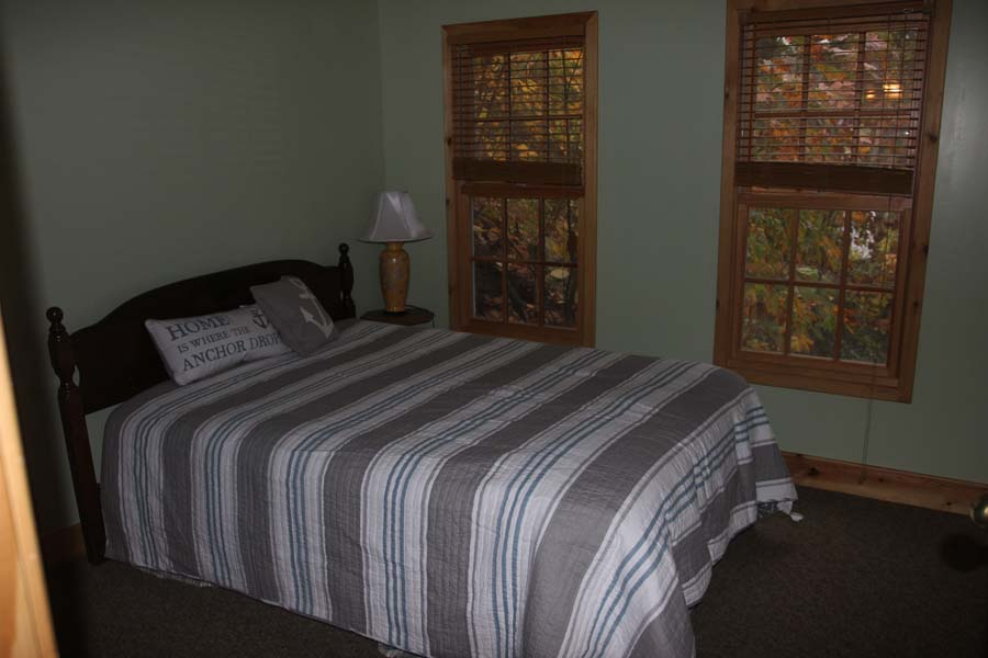 Queen bed in the second bedroom at Summer Ice Cottage on Keuka Lake